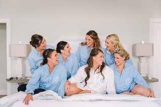 bride-and-bridesmaids-getting-ready-in-monogrammed-mens-button-up-shirts