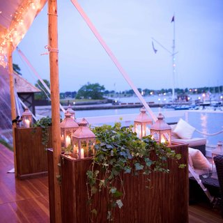 candles-in-lanterns-displayed-outside-the-reception-tent
