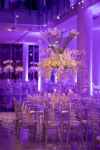 wedding reception modern design venue six10 purple violet lighting orchid calla lily flower arrangement