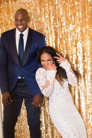 retired nba player brendan haywood and theresa tupea wedding reception gold sequin photo booth