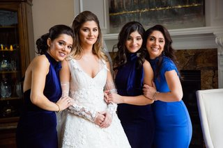 bride-with-sleeves-detachable-arm-sleeves-with-bridesmaids-mismatched-royal-blue-gowns-and-mother