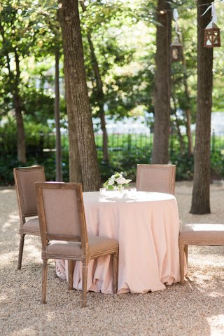 pink-tablecloth-with-rustic-wood-and-grey-taupe-chairs-by-tall-trees-at-meridian-house-in-washington