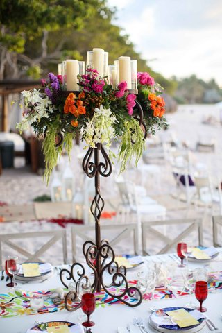 tall-iron-stand-colorful-flowers-candles-arrangement-cascading-beach-wedding-destination-mexico