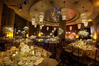 a-gold-concept-with-colorful-lights-and-centerpieces-of-varying-heights-at-new-years-eve-reception