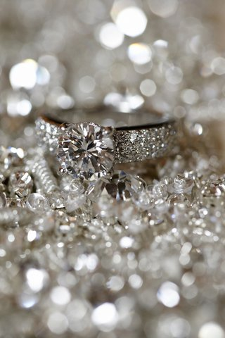 thick-diamond-band-with-round-cut-diamond-engagement-ring