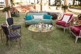 glass-table-with-copper-legs-antique-vintage-inspired-sofa-armchair-accent-under-canopy-lounge