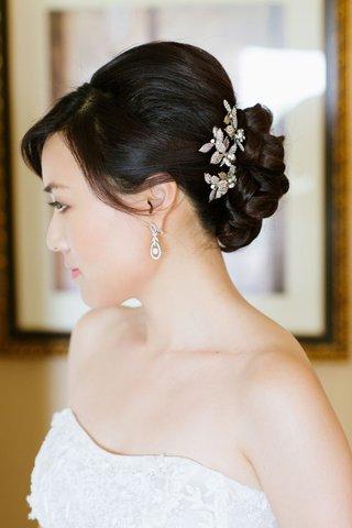 updo-with-flower-pins-around-braided-bun
