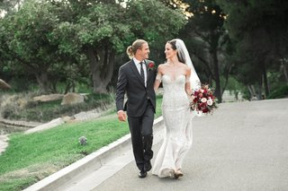 bride-in-pallas-couture-mermaid-wedding-dress-groom-with-man-bun-in-charcoal-suit-and-polka-dotted