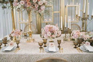 champagne-taupe-tablescape-featuring-tall-low-pink-rose-florals-gold-candelabra-different-sizes