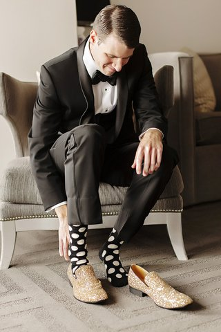 groom-with-black-socks-and-white-polka-dots-glittery-gold-shoes