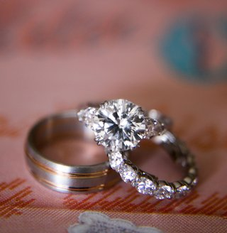 solitaire-diamond-engagement-ring-with-diamonds-on-setting-and-mens-wedding-band-with-rose-gold
