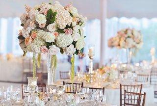 tent-wedding-centerpiece-with-white-hydrangea-pink-and-orange-flowers-amaranthus