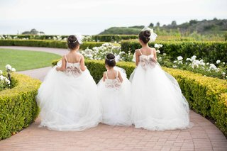 three-flower-girls-white-tulle-dresses-hairpieces-straps-ceremony-pelican-hill-wedding-newport-beach