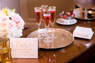 champagne-bar-special-signature-drinks-serving-platter-womens-bathroom-dallas-texas-wedding