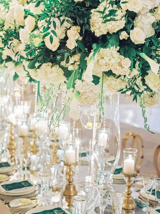 wedding-reception-long-table-white-hydrangea-rose-greenery-centerpiece-crystals-gold-candleholders