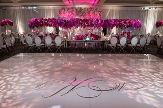 wedding-reception-white-dance-floor-silver-monogram-in-center-projected-lighting-gobo-flower-motif