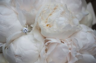 wedding-ring-solitaire-diamond-engagement-ring-pave-band-on-white-peony-bouquet