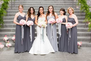 bridesmaids-in-long-grey-and-silver-dresses-with-pink-bouquets-and-silver-silk-ribbon