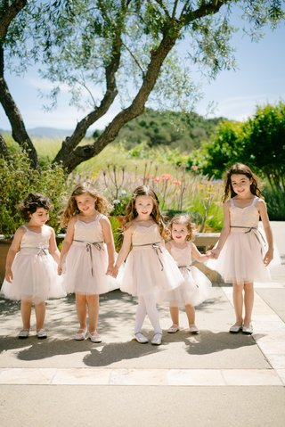 five-flower-girls-in-blush-dresses-with-tulle-skirts-silver-ballet-flats