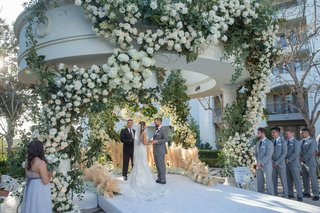 wedding-ceremony-gazebo-pampas-grass-white-flowers-greenery-raised-aisle-outdoor-ceremony-decor-idea