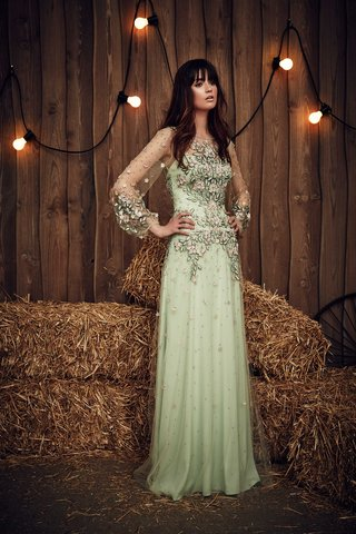 jenny-packham-2017-bridal-collection-apache-green-wedding-dress-sheer-sleeves-pink-flower-embellish