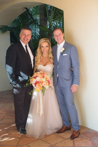 bride-in-strapless-trish-peng-wedding-dress-groom-in-grey-suit-and-reverend-clint-hufft-portrait