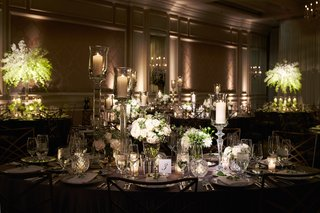 reception-in-ballroom-oval-table-velvet-linen-tall-candleholders-white-flowers-crystal-votives