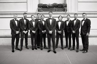 black-and-white-photo-of-groom-in-tuxedo-with-groomsmen-in-bow-ties-new-york-city