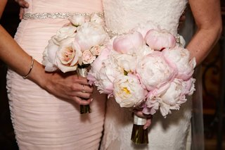 bride-with-light-pink-peony-wedding-bouquet-and-bridesmaid-with-light-pink-rose-bouquet