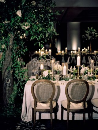 A Charming Fete Natural Reception Décor tree cane chairs greenery