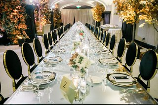 small-floral-centerpieces-line-the-middle-of-long-reception-tables