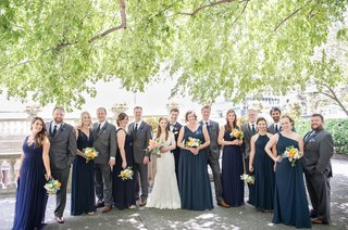 wedding-party-blue-bridesmaid-dresses-and-groomsmen-in-grey-suits-blue-ties-bride-romona-keveza