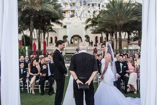 bride-and-groom-with-pastor-at-acqualina-resort-spa-outdoor-wedding-on-lawn