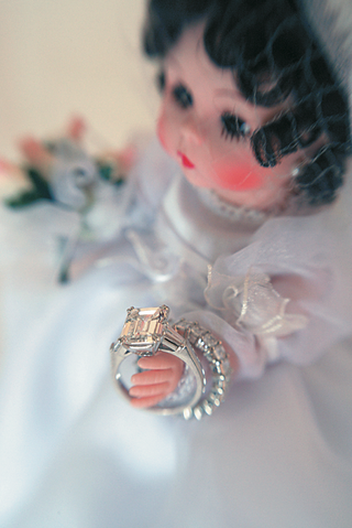 porcelain-doll-with-wedding-dress-holding-wedding-rings
