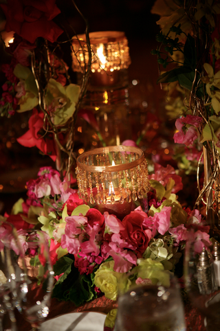 short-centerpiece-with-pink-and-green-flowers-and-gold-candles
