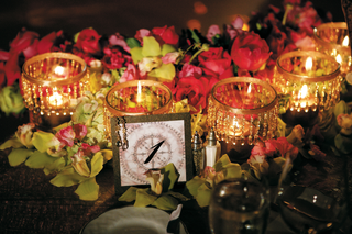 reception-table-name-with-gold-beaded-candles-and-flowers