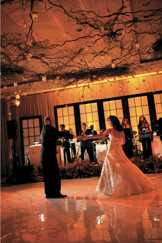 bride-and-grooms-first-dance-under-branches-and-candles