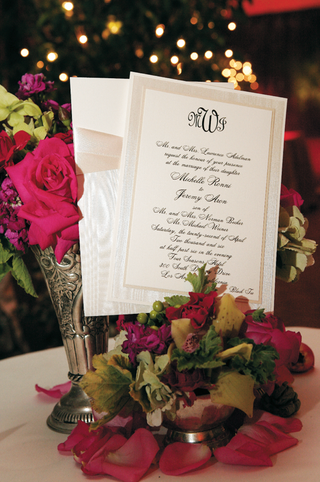 white-invitation-with-black-lettering-and-tan-border-and-ribbon