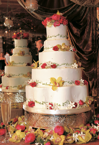 five-layer-white-cake-with-green-scroll-design-and-fresh-flowers