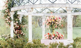 styled-shoot-wedding-inspiration-reception-table-under-gazebo-with-large-two-tier-centerpiece
