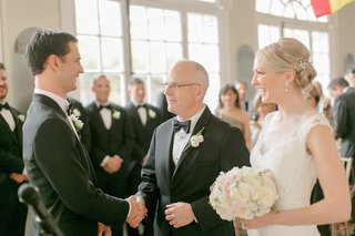 groom-father-of-the-bride-in-black-tuxes-shake-hands-bride-in-reem-acra-dress-with-illusion-neck