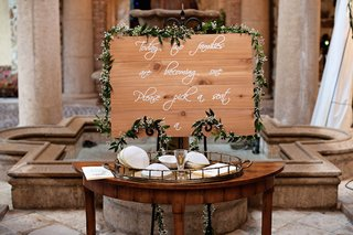 gold-tray-with-white-yarmulkes-and-wood-sign