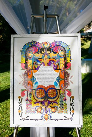 a-brightly-colored-ketubah-displayed-at-couples-traditional-jewish-ceremony
