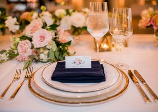 wedding-reception-place-setting-gold-rim-charger-plate-flower-print-place-card-with-entree-selection