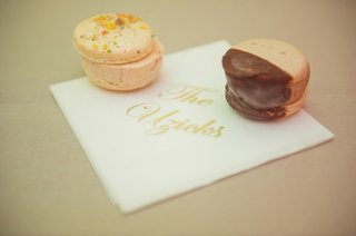 sprinkled-macaron-and-chocolate-dipped-macaron-ice-cream-sandwiches-on-personalized-napkin