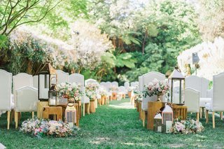 lawn-of-hotel-bel-air-wedding-ceremony-outdoor-grey-chairs-wood-legs-wood-side-tables-lanterns