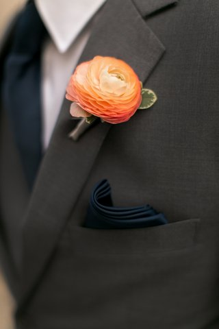 groomsman-in-grey-suit-navy-pocket-square-light-orange-ranunculus-boutonniere