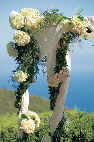 white-flowers-and-greenery-on-ceremony-canopy