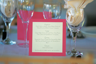 pink-and-white-menus-on-wine-glass-table