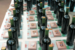 wine-bottles-box-of-chocolates-and-book-gifts